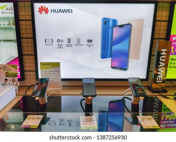 Bangkok, Thailand - May 1, 2019 : New smartphones HUAWEI on showcase with antitheft system. Smartphones HUAWEI in electronic store.