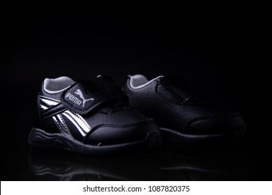BANGKOK, THAILAND -MAY 10,2018 PUMA shoe. Puma, a major German multinational company. Isolated on dark. Product shots