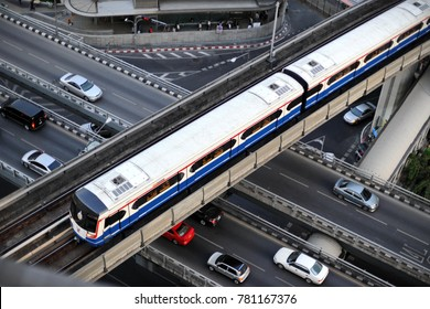 Bangkok, Thailand - May 11, 2012: A BTS Skytrain runs on elevated rails through the city centre's Silom district. Each train of the mass transport rail network can carry over 1,000 passengers.