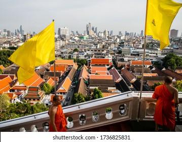 BANGKOK, THAILAND, MAY 11, 2019: yellow King's flag and Bangkok cityscape from Wat Saket Ratcha Wora Maha Wihan (Wat Phu Khao Thong, Golden Mount temple), a popular Bangkok tourist attraction