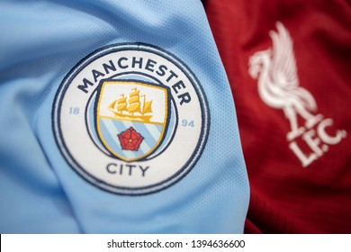 BANGKOK, THAILAND - MAY 11: Selective Focus on The Logo of Manchester City and Blured  Liverpool on Football Jerseys on May 11,2019. They will Compete in EPL for The Champion this Sunday