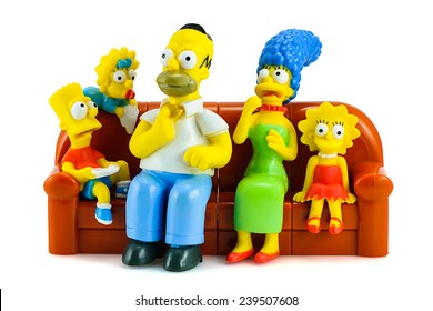 Bangkok, Thailand - May 13, 2014 : Simpsons family on sofa and see the scary movie figure toy character. There are plastic toy sold as part of the Burger King toys.