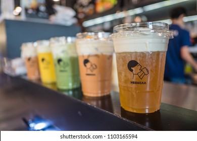 Bangkok, Thailand, May 13, 2018: Various of cheese ice drinks; mango smoothie, Thai tea,  matcha green tea, and signature oolong tea with whipped cream cheese at Heekcaa in Siam Discovery.