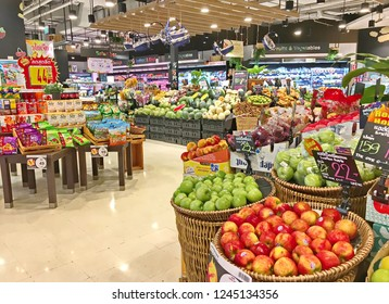 Bangkok, Thailand - May 13, 2018 : Shelf of fresh fruits dragon fruit, red apple, green apple, Longkong, papaya, mango, grape at Tops supermarket. Tops supermarket is a famous supermarket in Thailand