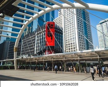 BANGKOK, THAILAND - May 15, 2018 : People walk to work around Sathorn district that is the major commercial district. There is skyscraper for walking from Bangkok Skytrain (BTS).