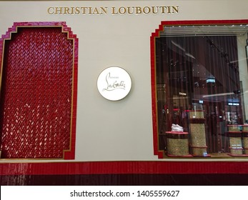 Bangkok, Thailand. May 15, 2019 - Christian Louboutin luxury boutique shoe store in shopping mall. Christian Louboutin is French luxury footwear and fashion designer.