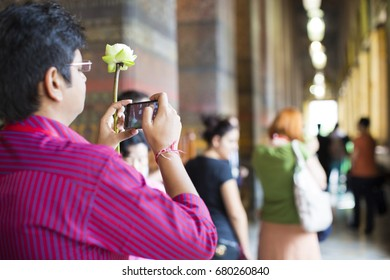 Bangkok, THAILAND -May 15: Tourist is taking a photo by phone in Wat Pho temple, Thailand, May 15, 2016.