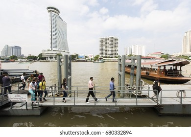 Bangkok, THAILAND -May 15: Tourists are walking on the bridge at a river ferry , May 15, 2016.