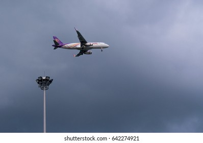 Bangkok, Thailand.- May 16, 2017 : Thai Smile Airway landing to Suvanabhumi airport. storm clouds in the background