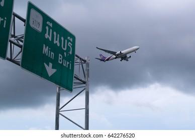 Bangkok, Thailand.- May 16, 2017. : Plane of Thai Airways in the storm clouds landing to Suvanabhumi airport.