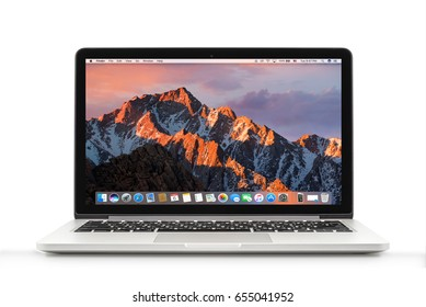 Bangkok, Thailand - May 16, 2017 : MacBook Pro with macOS Sierra background on the screen. MacBook Pro Retina 13-inch was created and developed by the Apple inc.
