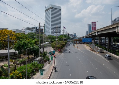 Bangkok, Thailand - May 17, 2019: Vibhavadi Rangsit road, with people driving on the road. Tall buildings, in front of the headquarters of the company. PTT gas station.