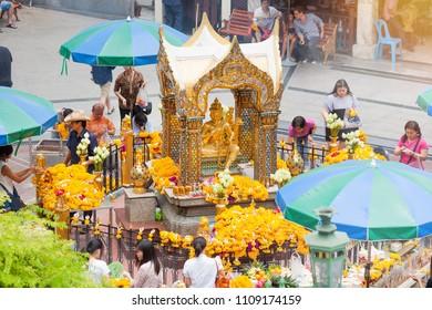 BANGKOK, THAILAND - MAY 18, 2017: Erawan Shrine on September 18. Tourists make a merit at Erawan Shrine at Ratchaprasong Junction, Grand Hyatt Erawan Hotel.
