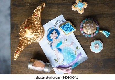 Bangkok, Thailand - May 18, 2019 : A photo of Arabian items on flat layout including Aladdin'a magic lamp, arabian style container box, sand glass bottle and Princess Jasmine mask sheet