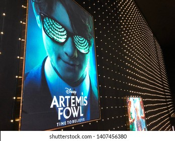 Bangkok, Thailand - May 18, 2019 : Billboard of Artemis Fowl cinema on wall at the theatre.Artemis Fowl cinema LED displays at the Theater.People go to see movie at night.