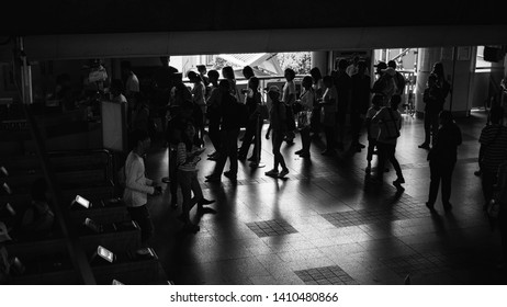 Bangkok, Thailand - MAY 18, 2019 : Urban crowd in rush hour are queueing to buy a BTS skytrain ticket in rush hour are queueing to buy a BTS skytrain ticket, shot from walkway BTS Victory Monument.
