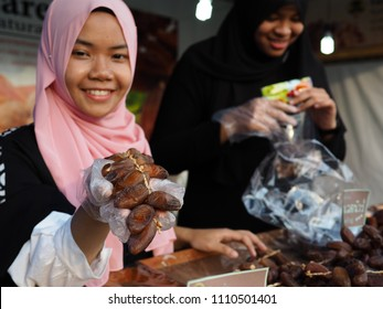 Bangkok, Thailand - May 19, 2018 : Muslim street vendors selling date palm fruit for breaking fast or iftar meal preparing during the holy month of Ramadan at halal market fair.