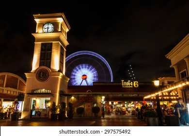 BANGKOK, THAILAND - MAY 19: Clock tower and ferris wheel at Asiatique The Riverfront  on May 19,2015 in Bangkok, Thailand. Asiatique The Riverfront is a large open-air market