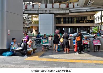 Bangkok, Thailand - May 2, 2017: Lottery tickets vendors on the sidewalk of Rama 1 Road.