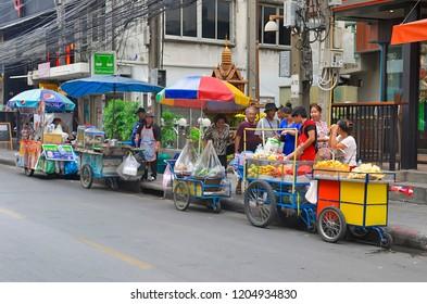 Bangkok, Thailand - May 2, 2017: Street food vendors wheeling carts on Sukhumvit Soi 4.
