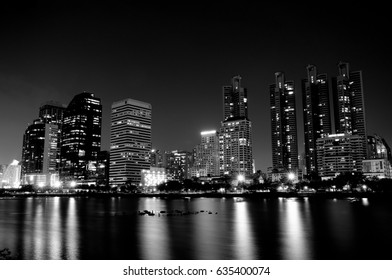 BANGKOK, THAILAND - MAY 2, 2017: A view of cityscape of Bangkok at night with reflections of lights (in monochrome).