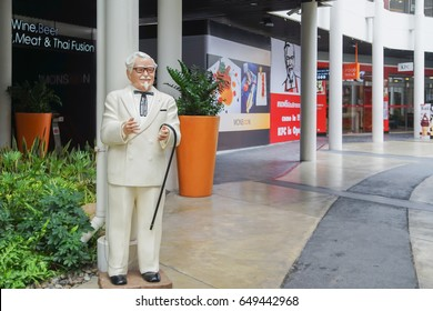 BANGKOK ,THAILAND- May 20 ,2017: Colonel Harland Sanders statue standing in front of Kentacky Fried chicken restaurant (KFC)