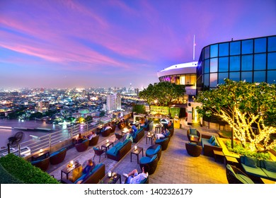 BANGKOK, THAILAND, MAY 20, 2019: Restaurant couch bar with view of Bangkok Cityscape at the Three Sixty Lounge of Millennium Hilton Bangkok Hotel in Bangkok, Thailand