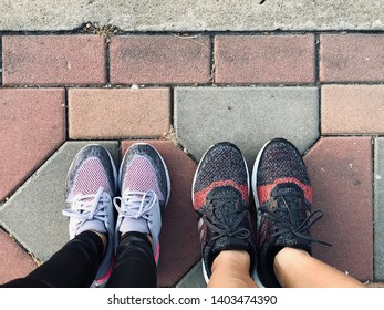 BANGKOK, THAILAND. MAY 20, 2019: the runners wear  stability running shoes ADIDAS Ultraboost ST and Nike Odyssey React 2, standing on the mosaic pavement floors.