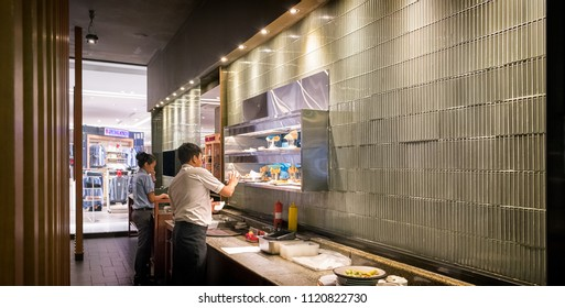 BANGKOK, THAILAND - MAY 20: Restaurant servers communicate with the kitchen regarding customer orders in Sizzler within The Mall Bangkae in Bangkok on May 20, 2018.