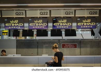 Bangkok, Thailand - May, 2016: Airline passengers at Etihad Airways check-in counter in Suvarnabhumi Airport