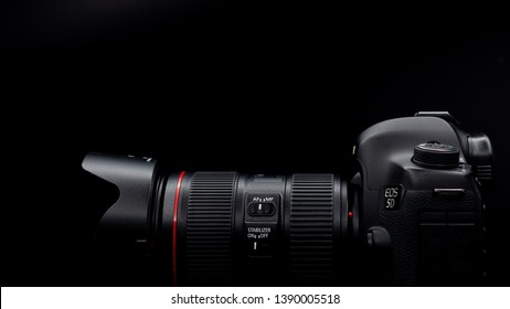 Bangkok, Thailand - May 2019 : close up Canon 5D Mark iii DSLR professional camera with Canon EF lens 24-105mm f/4L IS II EF USM photo in black studio in Thailand .