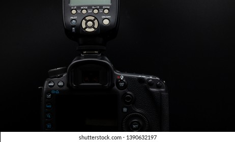 Bangkok, Thailand - May 2019 : close up back of Canon 5D Mark iii DSLR professional camera with digital flash was photo in black studio .