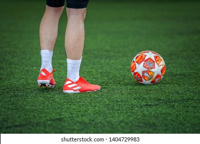 """Bangkok / Thailand - May 2019 : Football player is wearing adidas """"Nemeziz 19"""" the new model which is designed for agility and striker player. Global presented by Messi, Firmino, Draxler and Isco."""