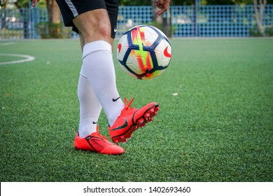 "Bangkok / Thailand - May 2019 : A player is training football on pitch by wearing nike ""Phantom Venom Elite"" which is for striker. It is presented by Harry Kane, Marcus Rashford and Lewandowski."