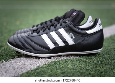 """Bangkok / Thailand - May 2020 : Adidas """"Copa mundial"""" is placed on football turf pitch, the model is most famous iconic classic football boots, the original is made for World Cup 1982."""