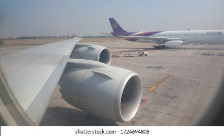 Bangkok, Thailand - May 2020: Thai Airways airplane parked on cargo ramp due to coronavirus Covid-19 pandemic. View from Boeing 747-8F parked next to it