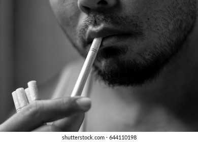 Bangkok, Thailand - MAY 21, 2017 : Close up Asian man smokes cigarette.