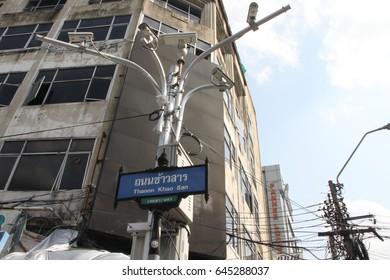 Bangkok, Thailand - May 21, 2017 - Khao san road sign and close circuit camera pole.