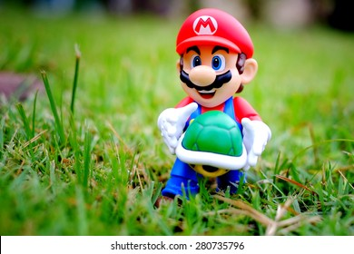 BANGKOK, THAILAND - MAY 22 2015: Super Mario Bros figure in park. ( MAY 22, 2015 in Bangkok, Thailand )