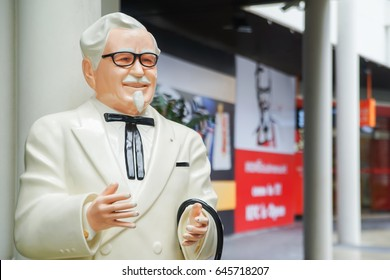 BANGKOK ,THAILAND- May 23 ,2017: Colonel Harland Sanders statue standing in front of Kentacky Fried chicken restaurant (KFC)