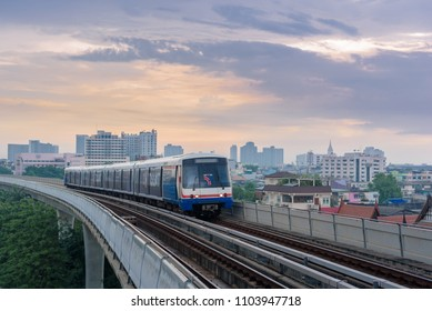 Bangkok, Thailand - May 23 2018: The Bangkok Mass Transit System BTS Sky train with sunset background and train is arriving at station. Transportation Concept.