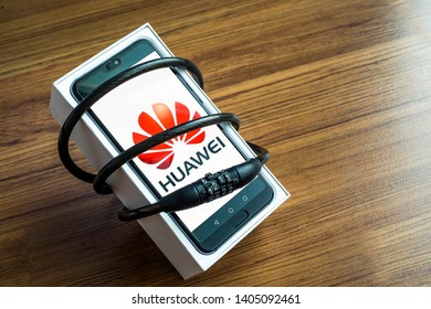 Bangkok, Thailand - May 23, 2019: Huawei phones with decoders on artificial wood flooring in the home, Huawei security issues, business crises, Huawei logo screens