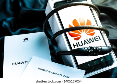Bangkok, Thailand - May 23, 2019: Huawei phone with decoder lock,There are boxes and warranties,on black background, Huawei security issues, business crises, Huawei logo screens.