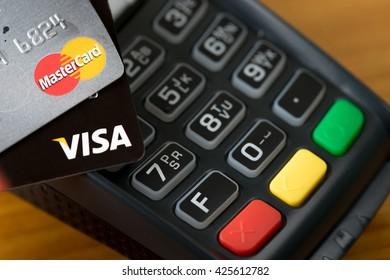Bangkok, Thailand - May 24, 2016: Closeup of VISA credit cards on the credit card machine.