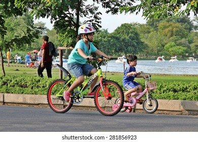 BANGKOK THAILAND - MAY 24 : Unidentified Biker ride a bicycle for exercise on May 24, 2015 at Rama 9 park in Bangkok, Thailand