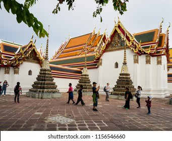 Bangkok, Thailand - May 25, 2018: Tourists visiting and taking photo at  Wat Pho Temple, one of the famous temple in Bangkok, Thailand.