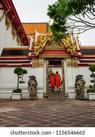 Bangkok, Thailand - May 25, 2018: The unidentified two Buddhist novice monks entering the side entrance of Wat Pho Temple, one of the famous temple in Bangkok, Thailand.