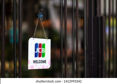 Bangkok, Thailand - May 26, 2019: JCB credit cards and welcome sign hangs in front of a shopping store in in Bangkok, Thailand. JCB is a credit card company based in Tokyo Japan.