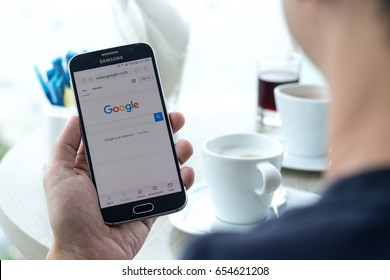 BANGKOK, THAILAND - May 27, 2017: Google search engine on web page app on smart phone with user sign in registration screen using social networking from anywhere office, home workplace in coffee shop.