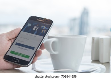BANGKOK, THAILAND - May 27, 2017: Facebook signup web page app on smart phone with user sign in registration screen using social networking from anywhere office, home workplace in coffee shop.